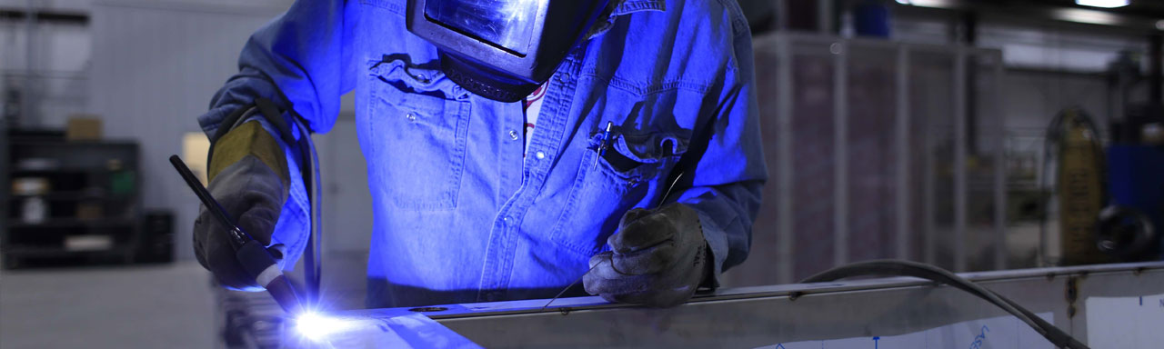 Welder in a manufacturing plant.