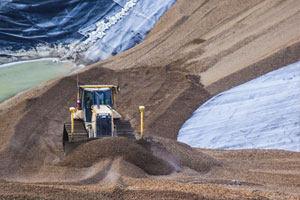 Bulldozer moving gravel at Seneca Landfill.
