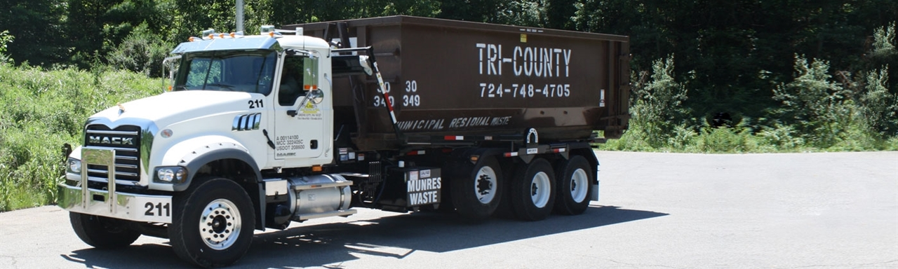 Tri-County garbage truck sitting outside in Grove City, PA.