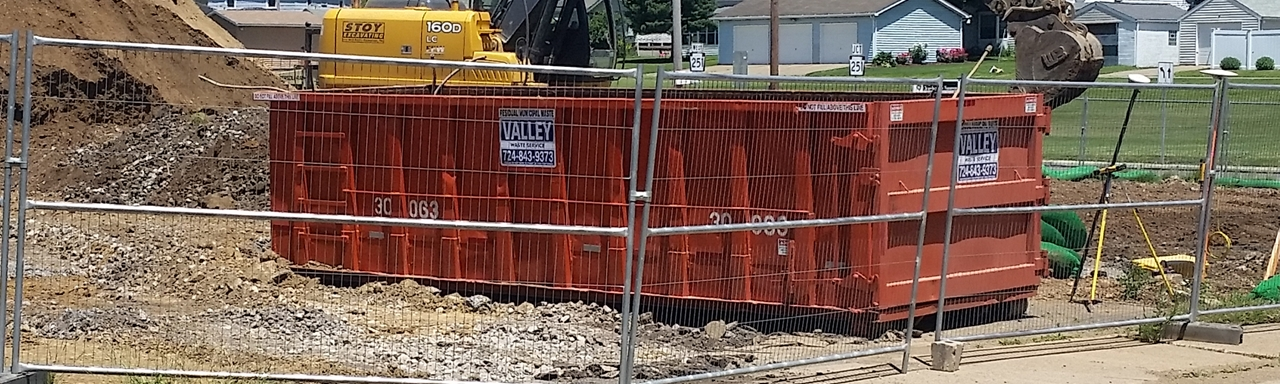 Valley Waste roll-off dumpster at a construction site.