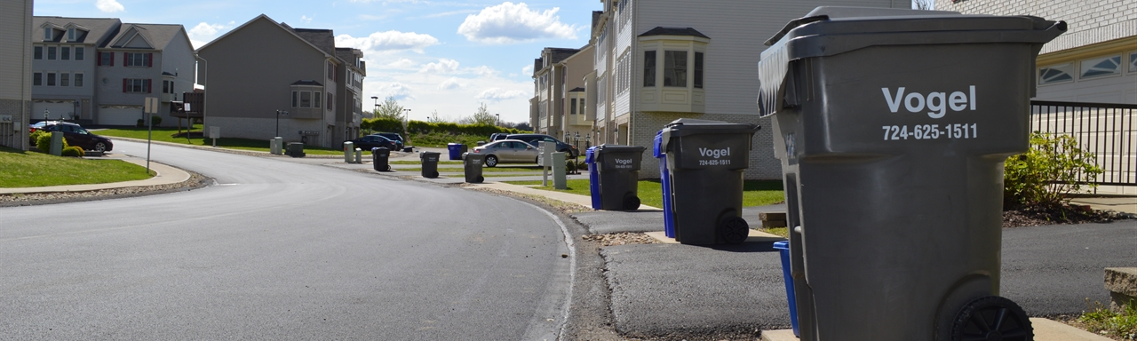vogel disposal service garbage cans and recycling bins on street in seven fields neighborhood