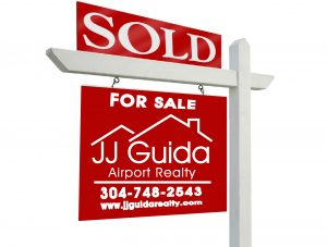 sold real estate sign | JJ Guida Airport Realty