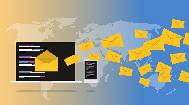 yellow email envelop in front of laptop computer