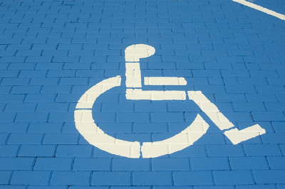 handicap symbol painted in white on a blue brick background