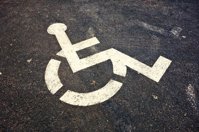 handicap accessible logo painted in white on asphalt