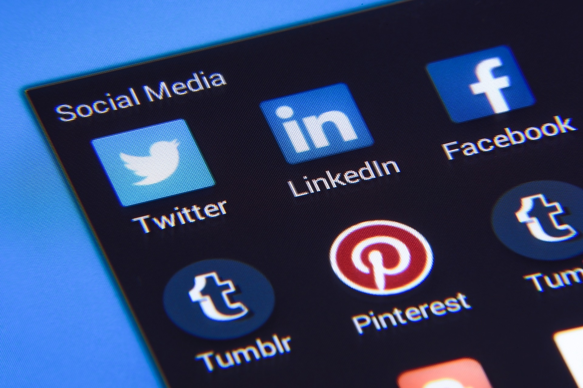 text and icons of social media companies on a screen