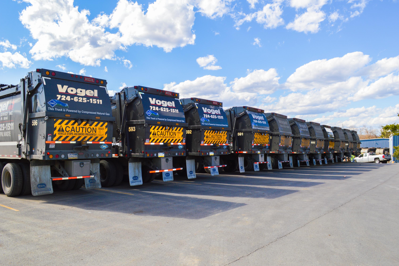 Row of Vogel Holding trucks