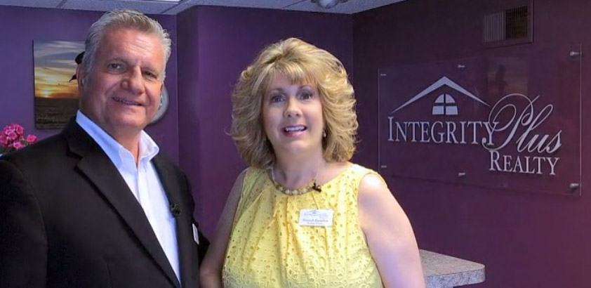 Interior portrait of Integrity Plus Realty owners