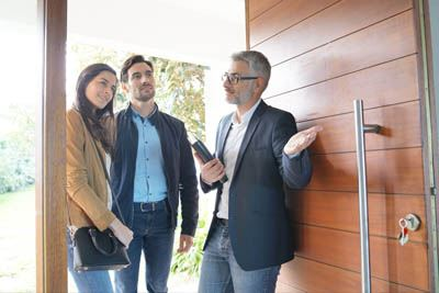 realtor showing listing to home buyers