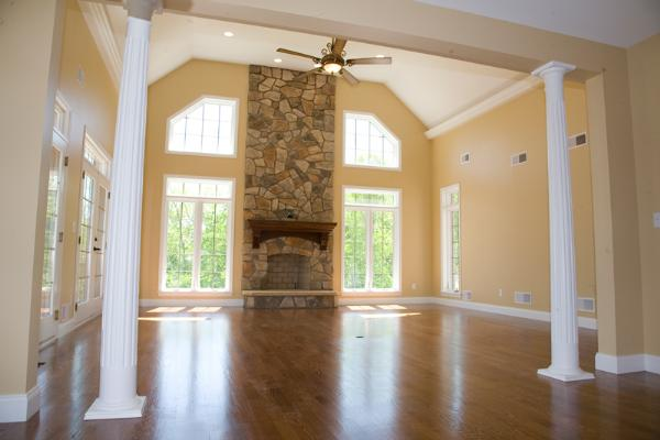 family room with stone fireplace and ceiling fan