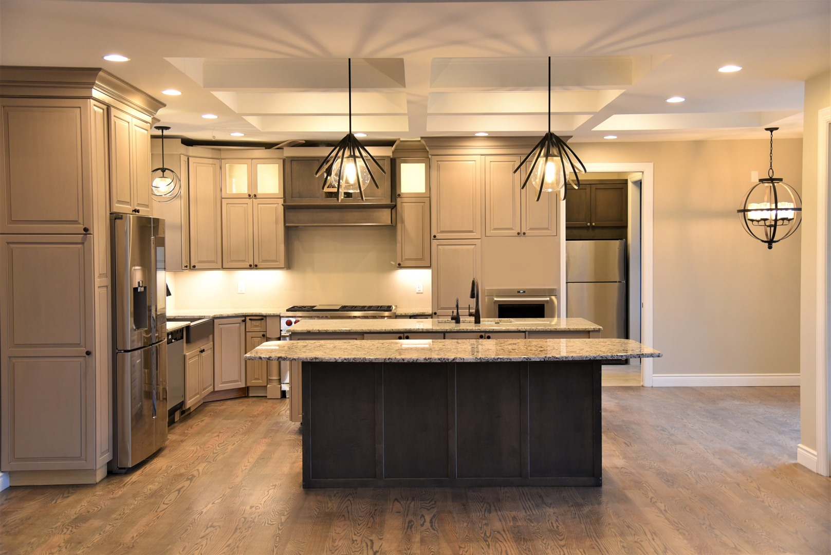 beige colored kitchen with lighting