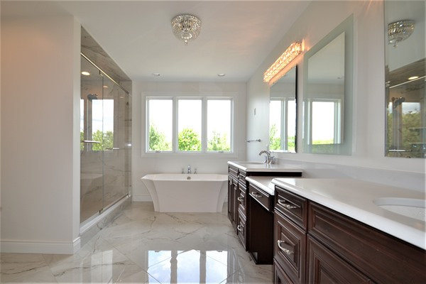 bathroom with white tub