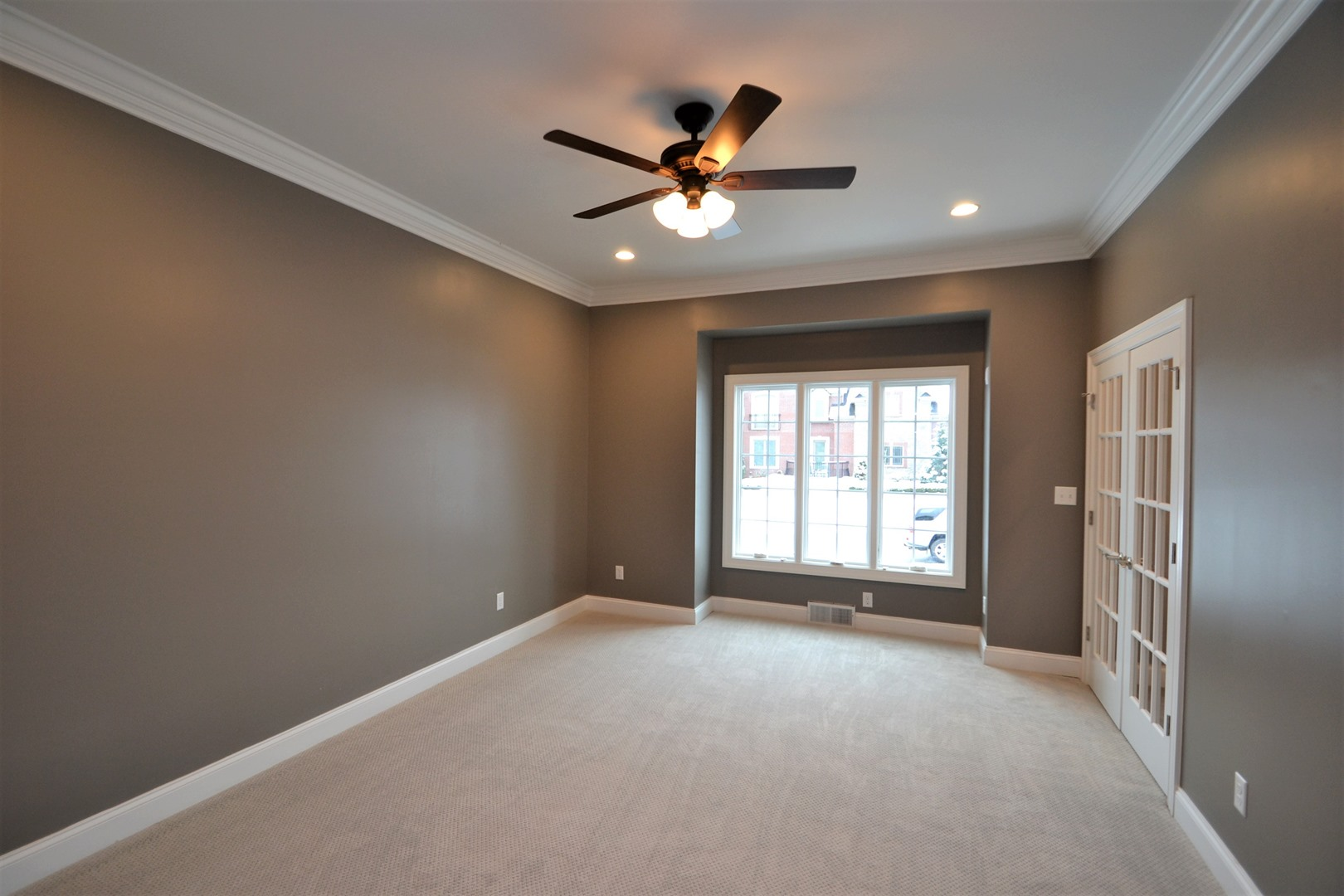 bedroom with ceiling fan and triple pane window