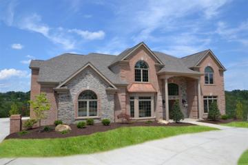 brown brick home in neighborhood setting