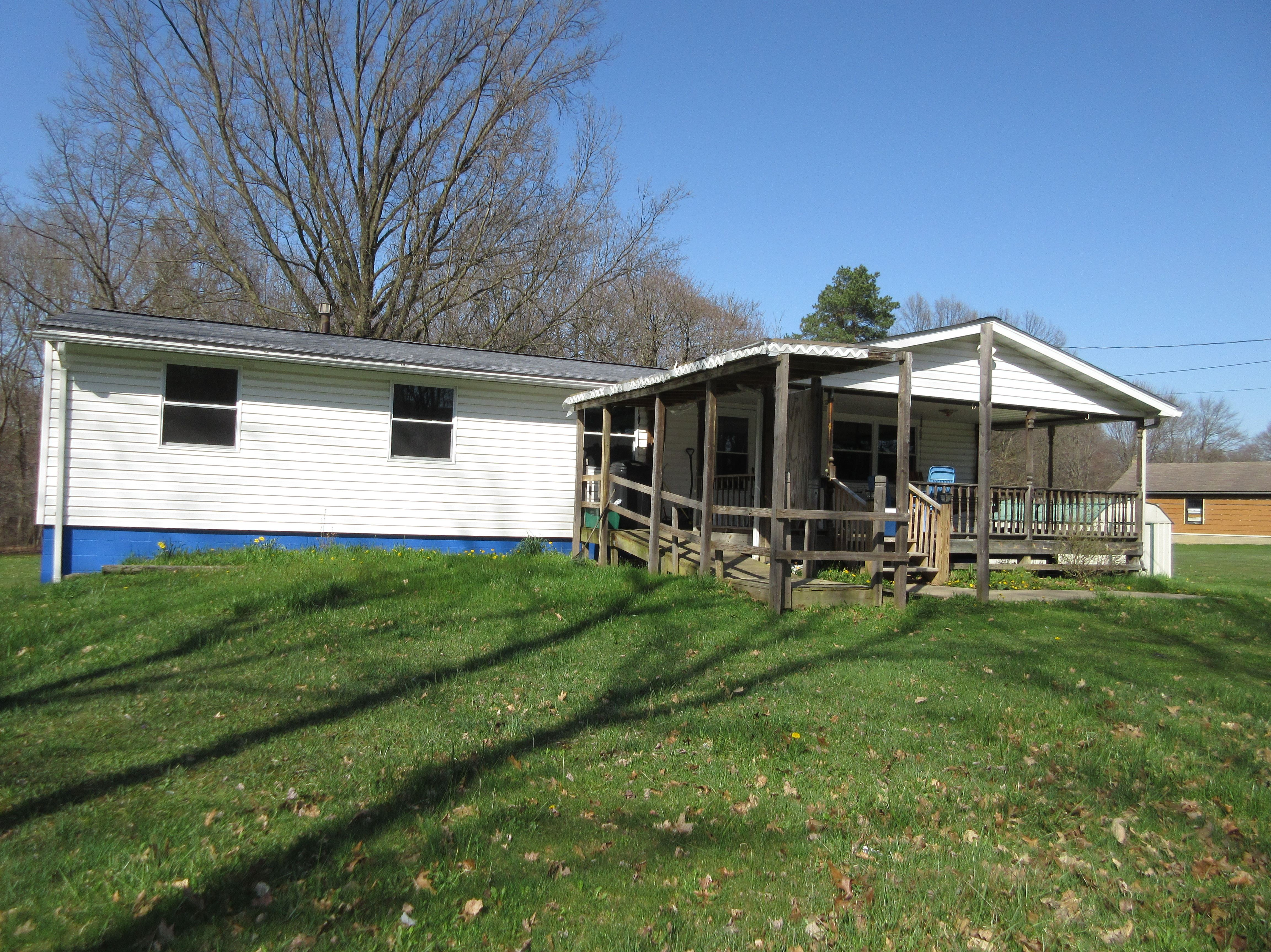 SOLD! -   Sits in a country setting on 2.6 acres with 4 bedrooms, 1 bath.  Entrance is from the front covered porch which ...