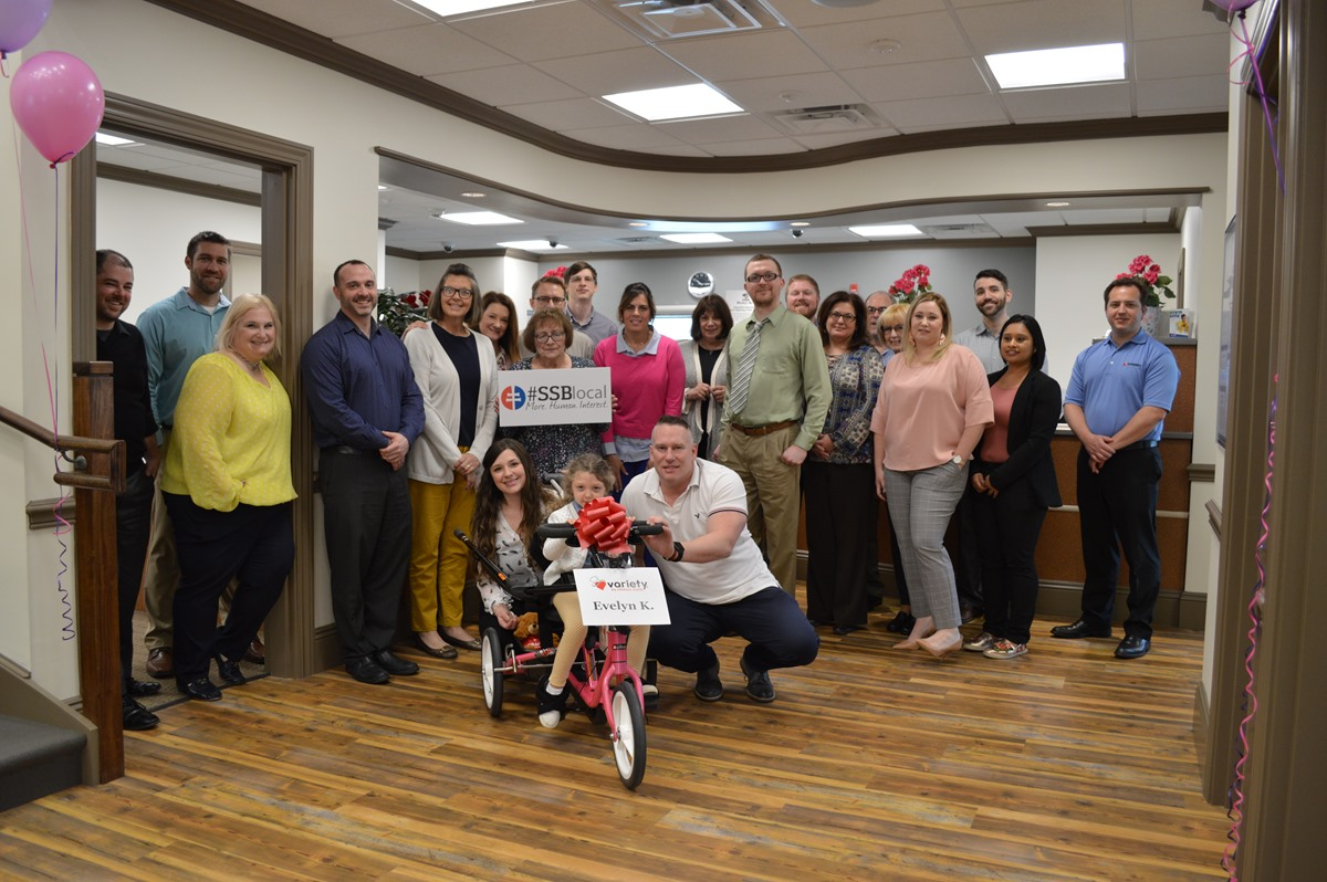 ssb bank donates recumbent bike to local girl