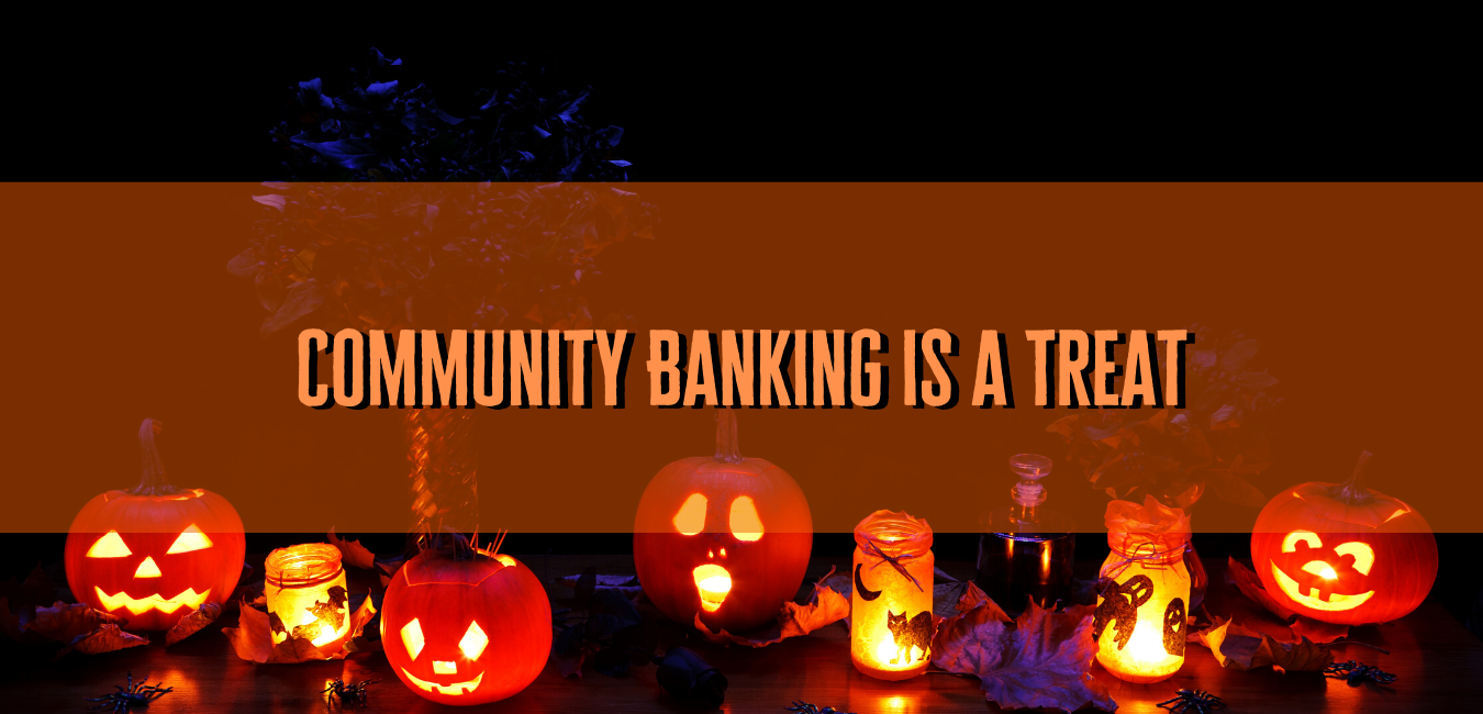 "pumpkins with words ""community banking is a treat"""