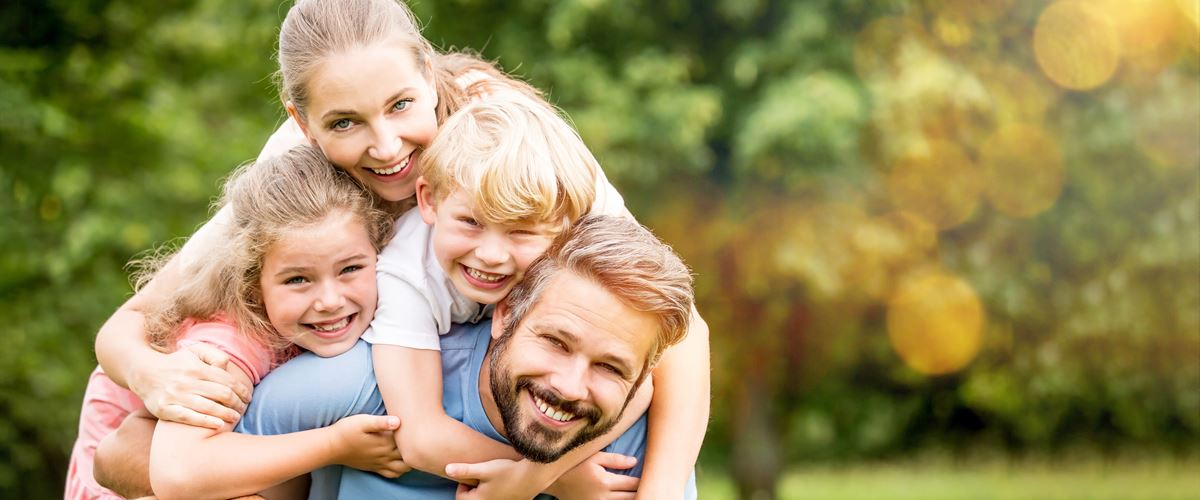 happy family of four celebrating financial freedom