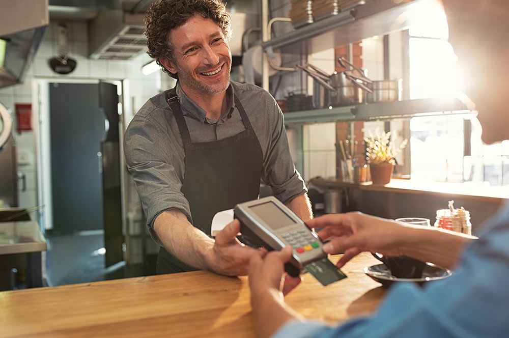 Merchant and customer completing a transaction with a credit card