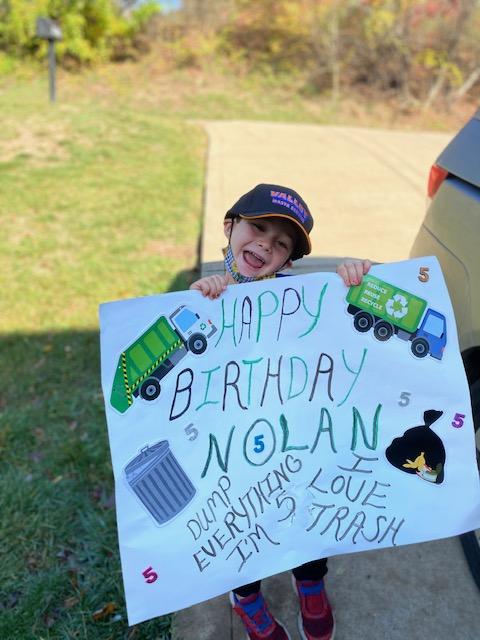 nolan holding a poster
