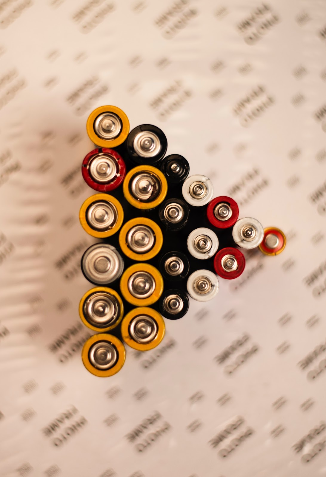 group of batteries on a table.